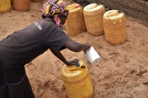The Water Project: Kiteta Community A -  Filling Up Container