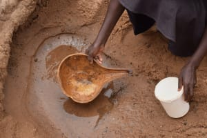 The Water Project: Kiteta Community A -  Scooping Water