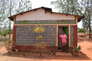 The Water Project: Kiteta Community A -  Zipporah Wanza Mutua Stands At Her Home