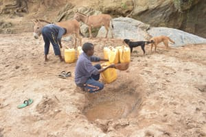 The Water Project: Mbitini Community -  Filling Up Container