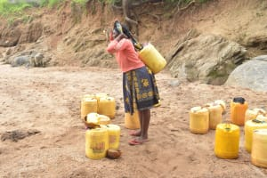 The Water Project: Mbitini Community -  Preparing To Walk Home With Water