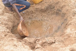The Water Project: Mbitini Community -  Scooping Water