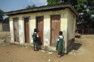 The Water Project: Lungi, Kasongha, DEC Kasongha Primary School -  Pupils Waiting To Use Latrine