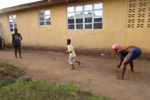 The Water Project: Lungi, Mahera, Mahera Health Clinic -  Kids Playing Stone Ball