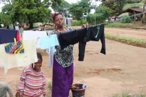 The Water Project: Lungi, Mahera, Mahera Health Clinic -  Lady Hanging Clothes