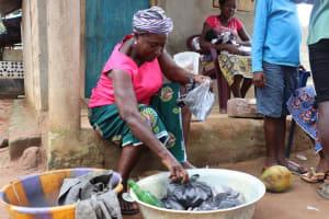 The Water Project: Lungi, Mahera, Mahera Health Clinic -  Old Woman Selling Charcoal