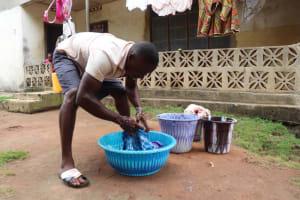 The Water Project: Lungi, Mahera, Mahera Health Clinic -  Washing Clothes