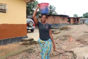 The Water Project: Lungi, Mahera, Mahera Health Clinic -  Woman Carrying Water