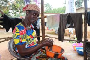 The Water Project: Lungi, Mahera, Mahera Health Clinic -  Woman Cleaning Fish