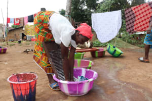 The Water Project: Lungi, Mahera, Mahera Health Clinic -  Woman Laundering