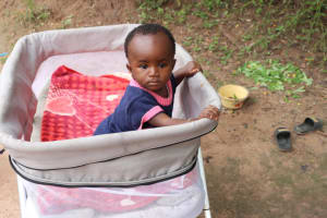 The Water Project: Lungi, Rosint, #26 Old Town Road -  Baby Sitting In Playpen