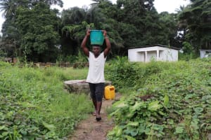 The Water Project: Lungi, Rosint, #26 Old Town Road -  Young Boy Carrying Water