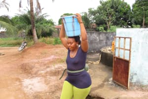 The Water Project: Lungi, New York, Robis, #7 Masata Lane -  Lady Carrying Water