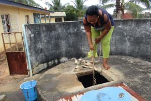 The Water Project: Lungi, New York, Robis, #7 Masata Lane -  Lady Collecting Water