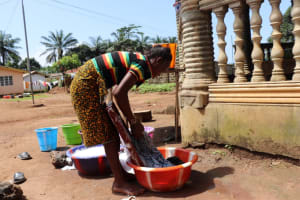 The Water Project: Lungi, New York, Robis, #7 Masata Lane -  Young Woman Washing Clothes