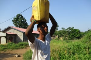 The Water Project: Lungi, New London, #10 Dankama Street -  Boy Carrying Water