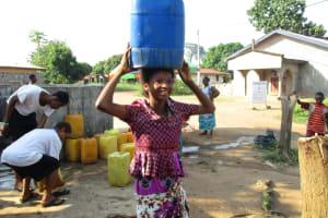 The Water Project: Lungi, New London, #10 Dankama Street -  Girl Carrying Water