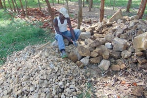 The Water Project: Nanganda Primary School -  Breaking Stones Into Gravel