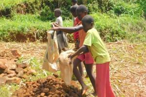 The Water Project: Emulembo Community, Gideon Spring -  Kids Help Deliver Rocks