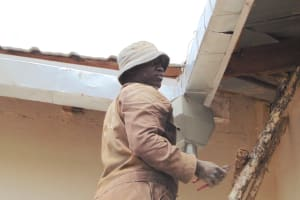 The Water Project: Ebulonga Mixed Secondary School -  Artisan Fits The Guttering System