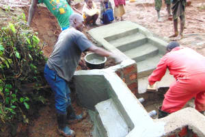 The Water Project: Munenga Community, Francis Were Spring -  Cement And Plaster Work As Children Look On