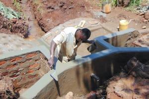 The Water Project: Masuveni Community, Masuveni Spring -  Plastering Headwall