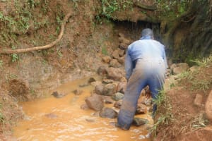 The Water Project: Emulembo Community, Gideon Spring -  Backfilling Begins