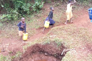 The Water Project: Shikhombero Community, Atondola Spring -  Carrying Water