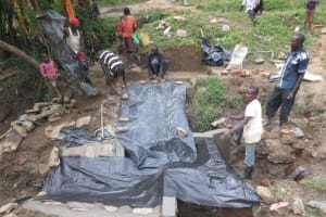 The Water Project: Sambaka Community, Sambaka Spring -  Covering The New Cement To Dry