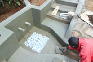 The Water Project: Munenga Community, Francis Were Spring -  Tile Setting