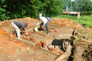 The Water Project: Kapkures Primary School -  Mixing Cement For Bricklaying