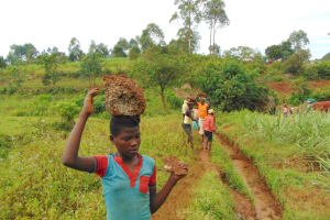 The Water Project: Munenga Community, Francis Were Spring -  Carryin Rocks To The Spring