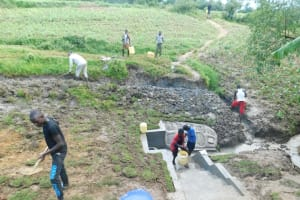 The Water Project: Sambaka Community, Sambaka Spring -  Digging Escape Channels Planting Grass And Kids Wash The Spring Steps