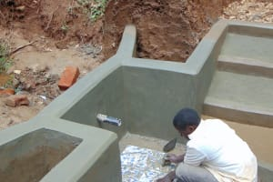The Water Project: Bumira Community, Madegwa Spring -  Tile Setting
