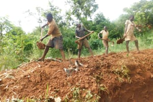 The Water Project: Emulembo Community, Gideon Spring -  Community Members Help Backfill