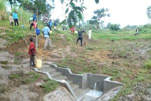 The Water Project: Sambaka Community, Sambaka Spring -  Community Members Help Level The Surrounding Area