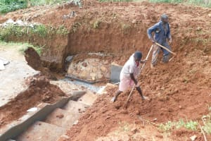 The Water Project: Emulembo Community, Gideon Spring -  Helping Level The Surrounding Area