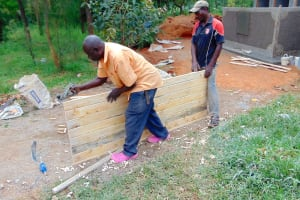 The Water Project: Ebulonga Mixed Secondary School -  Planing The Latrine Doors