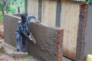 The Water Project: Banja Primary School -  Cementing Latrine Walls