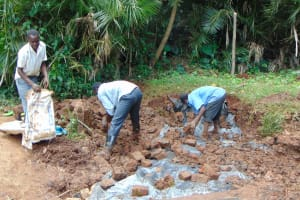 The Water Project: Masuveni Community, Masuveni Spring -  Covering Tarp With Soil