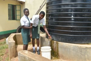 The Water Project: Makunga Secondary School -  Students Collect Water From A Small Plastic Tank
