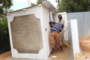 The Water Project: Ebulonga Mixed Secondary School -  Adjusting Hardware