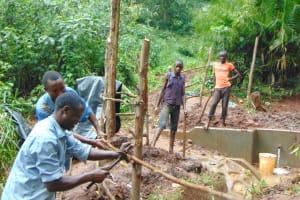 The Water Project: Masuveni Community, Masuveni Spring -  Building Fence Around Spring