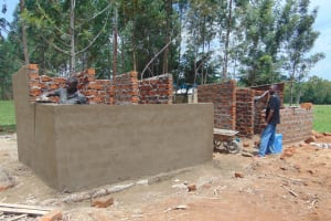 The Water Project: Nanganda Primary School -  Cementing Latrines