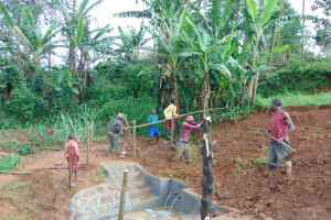 The Water Project: Munenga Community, Francis Were Spring -  Soil Backfilling Over Tarp