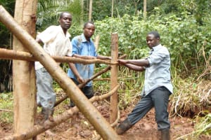 The Water Project: Masuveni Community, Masuveni Spring -  Adjusting The Fence