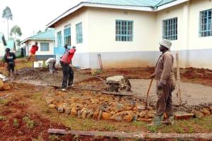 The Water Project: Ebulonga Mixed Secondary School -  Laying Rain Tank Foundation
