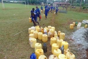 The Water Project: Demesi Primary School -  Students Deliver Water For Construction