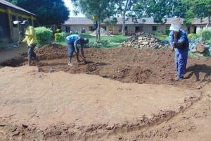 The Water Project: Nanganda Primary School -  Excavating Rain Tank Site