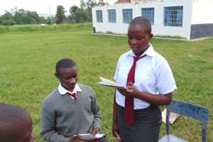 The Water Project: Ebulonga Mixed Secondary School -  A Student Shares Her Groups Work